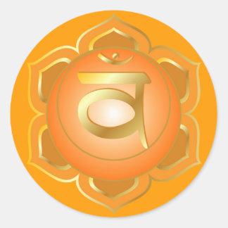Svadisthana eller sacral chakraklistermärke runt klistermärke