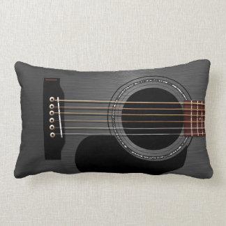 Svart akustisk gitarr för aska kudde