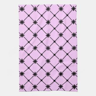 Svart argt mönster på rosa kökshandduk