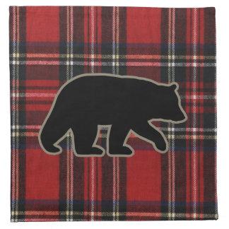 Svart björnSilhouette på röd pläd Tygservett