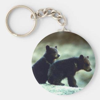 Svart björnungar rund nyckelring