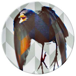 Svart fågel tallrikar i porslin