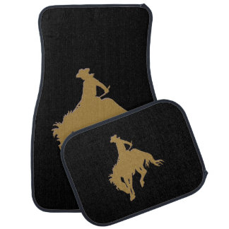Svart guld- Cowboy som sparkar bakut hästen Bilmatta