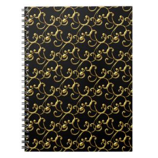 Svart guld virvlar runt den spiral anteckningsbok med spiral