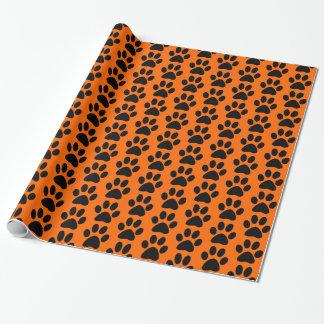 Svart hund/katt/djur tass avtryck på orangen presentpapper