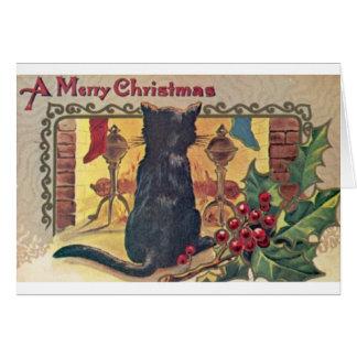Svart katt för vintage på spisjulkortet hälsningskort