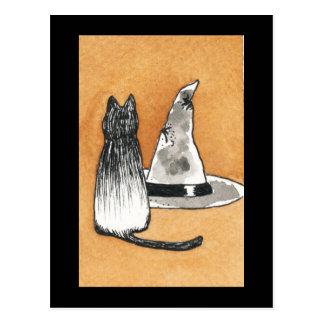 Svart katt med häxahattvykortet vykort