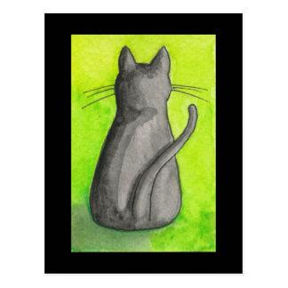 Svart katt på grön vykort