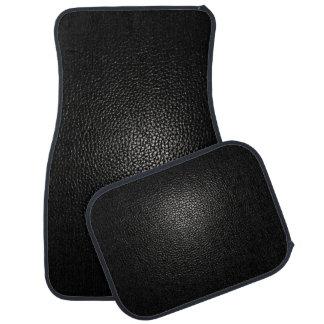 Svart läder på svart bilmatta