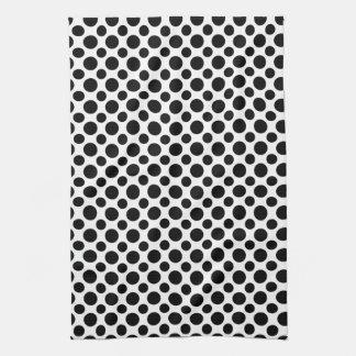 Svart liten vitpolka dots som är stor och kökshandduk