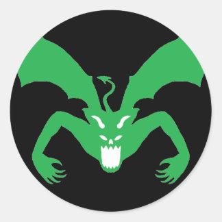 Svart och grön djävulen runt klistermärke