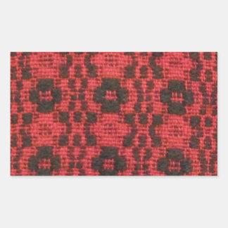Svart och rött rektangulärt klistermärke