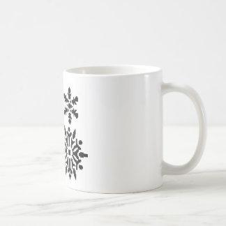 Svart snöflingor kaffemugg
