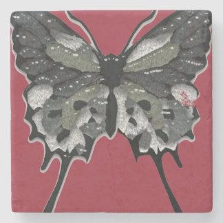 Svart texturerad fjäril stenunderlägg