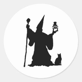 Svart trollkarl runt klistermärke