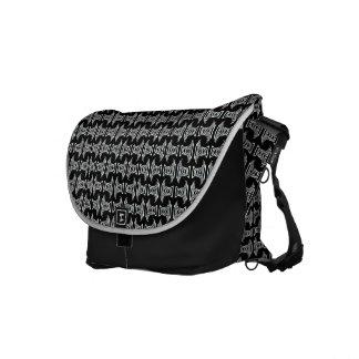 svart vittikimönster kurir väskor