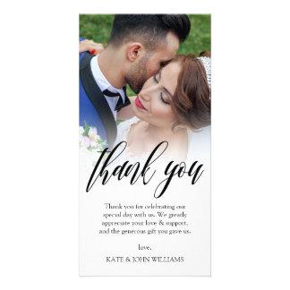 Svarten skrivar överdrar bröllopfototack fotokort