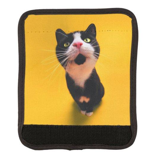 Svartvit katt-smoking katt-husdjur bagagehandtagskydd