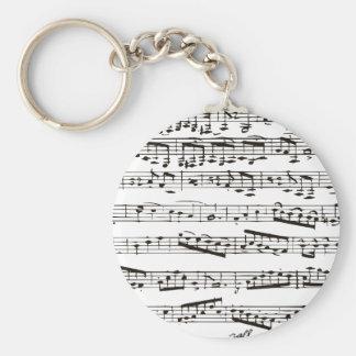 Svartvit musik noter rund nyckelring