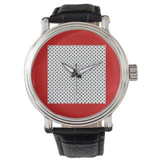 Svartvit polka dots på den röda bakgrundsklockan armbandsur