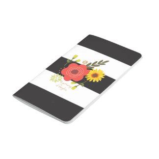 Svartvit randig journal med blommor