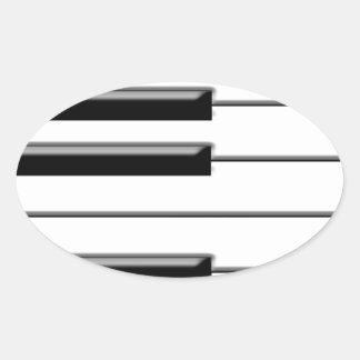 Svartvitt piano ovalt klistermärke