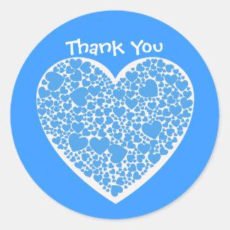 Tack-, blått- och vithjärtor runt klistermärke