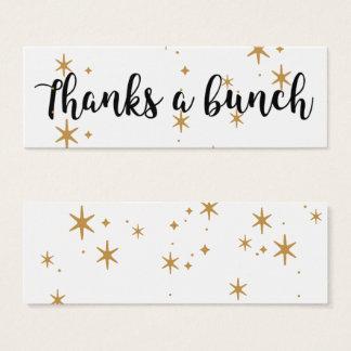 Tack strilade guld- stjärnor för en grupp litet visitkort