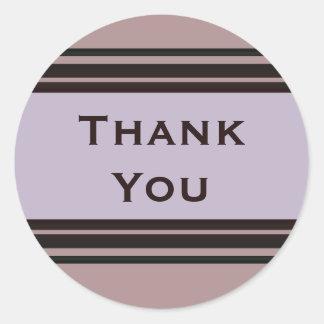 Tacka dig som är purpurfärgad med svart runt klistermärke