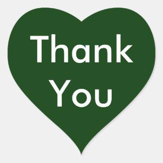 Tackhjärtaklistermärkear på mörk - grön bakgrund hjärtformade klistermärken