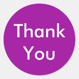 Tackklistermärkear på purpurfärgad bakgrund runda klistermärken