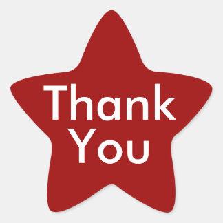 Tackklistermärkear på röd bakgrund stjärnformat klistermärke