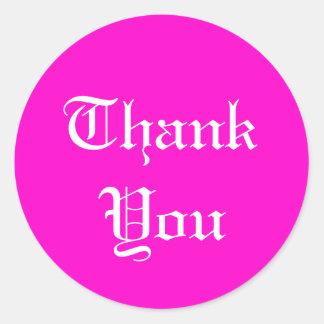 Tackklistermärkear på rosa bakgrund rund klistermärke