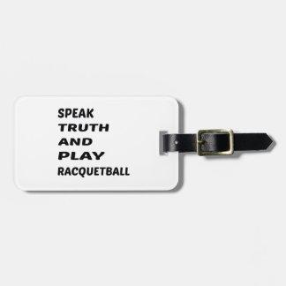 Tala sanning och leka racquetball.en bagagebricka