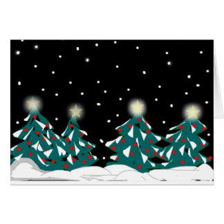 Tände snö täckte grästräd hälsningskort