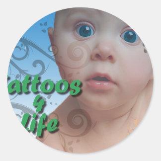 tatueringen undertecknar runt klistermärke