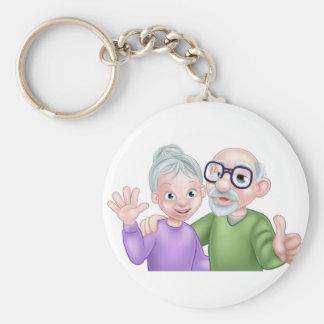 Tecknadpensionären kopplar ihop rund nyckelring