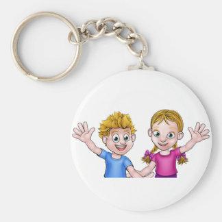 Tecknadpojke och flicka rund nyckelring