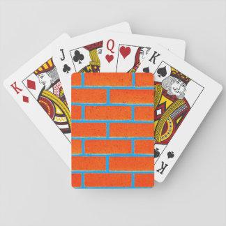 Tegelstenvägg som leker kort spelkort