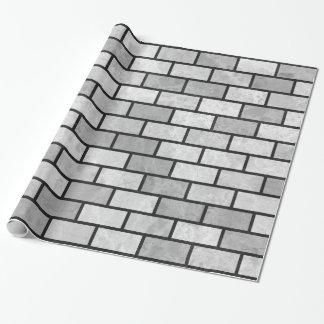 Tegelstenvägg som slår in papper presentpapper