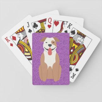 Terrier för amerikangroptjur som leker kort spel kort
