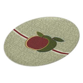Texturerade äpplen pläterar (cranberryen/vis man) tallrik