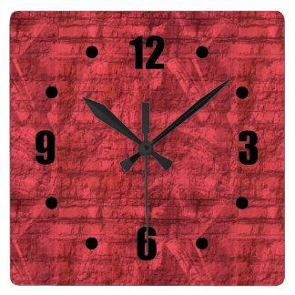 Texturerat rött fyrkantig klocka