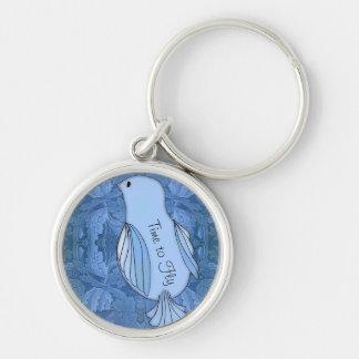 Time för att en blåsångare ska flyga rund silverfärgad nyckelring