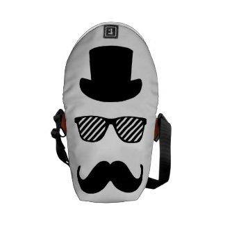 Top hat, exponeringsglas och moustache messenger bag