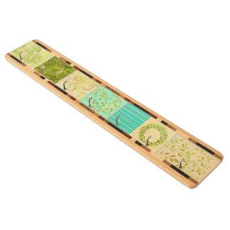 Tränyckel- kugge i grönt-/gultdesign nyckelhängare av lönnträ
