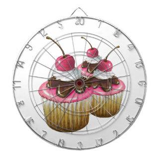 Tre muffins med körsbäret överst: Rosa isläggning Piltavla