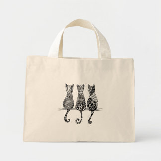 Tre svartvita katter på en hänga lös mini tygkasse