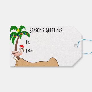Tropisk jul för palmträd och för Flamingos Presentetikett
