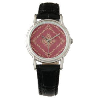 Tudor inspirerade guld- och röd armbandsur